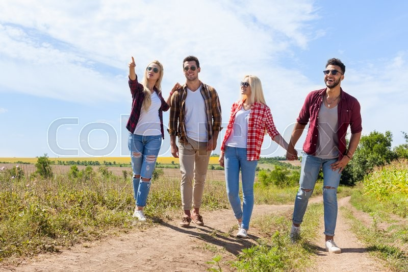 people group friends walking countryside road two couple happy smile