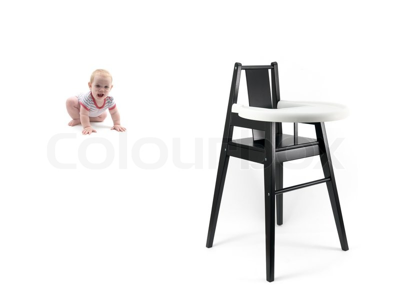 a small baby girl and a high chair stock photo colourbox