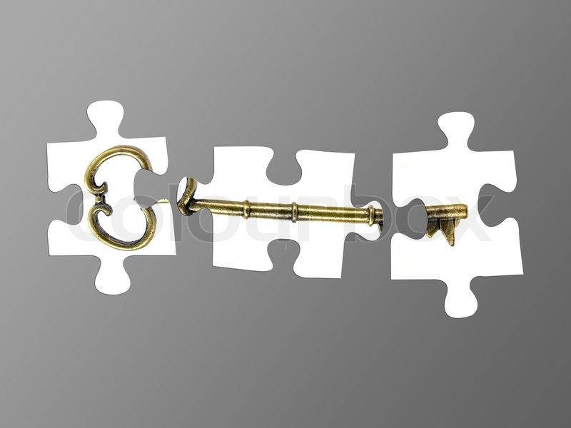 Jigsaw Puzzle Pieces Of A Key Isolated Against A Grey