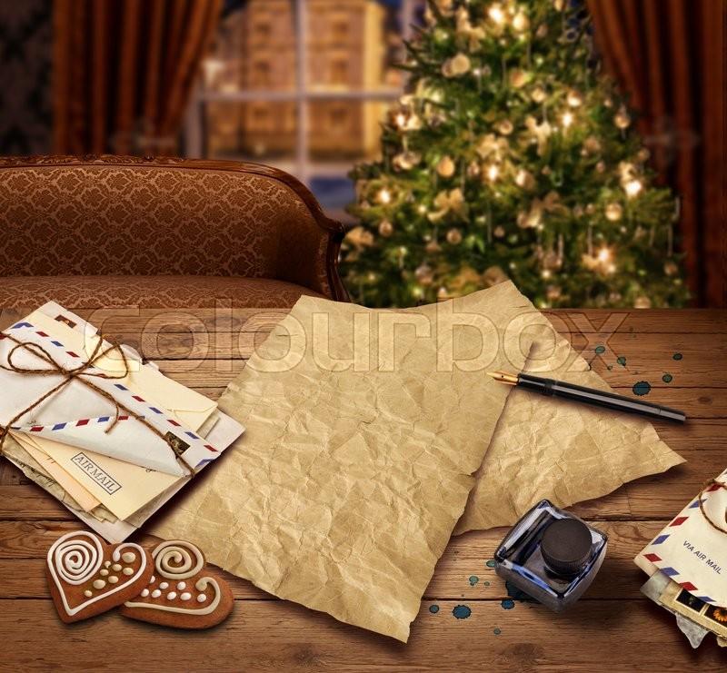 Christmas wish present list letter to Santa on christmas tree background, stock photo