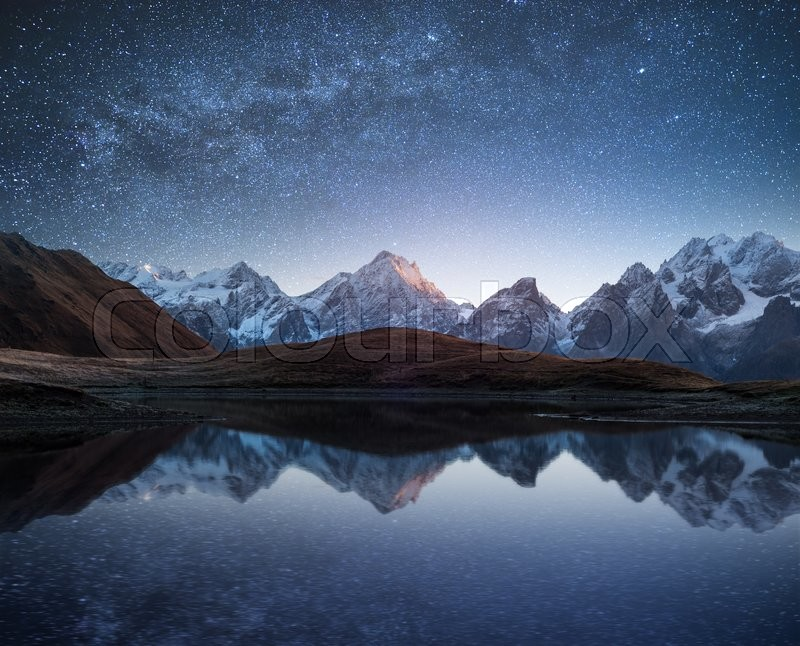 Night sky with stars and the Milky Way over a mountain lake. Collage of two frames. Art processing photos, stock photo