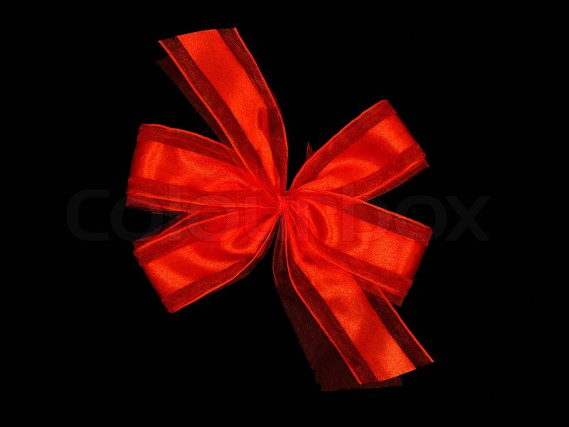 A red bow isolated against a black background | Stock ... | 800 x 600 jpeg 48kB
