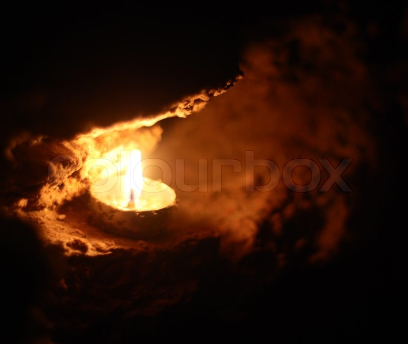 & Lighting candle in the cave   Stock Photo   Colourbox
