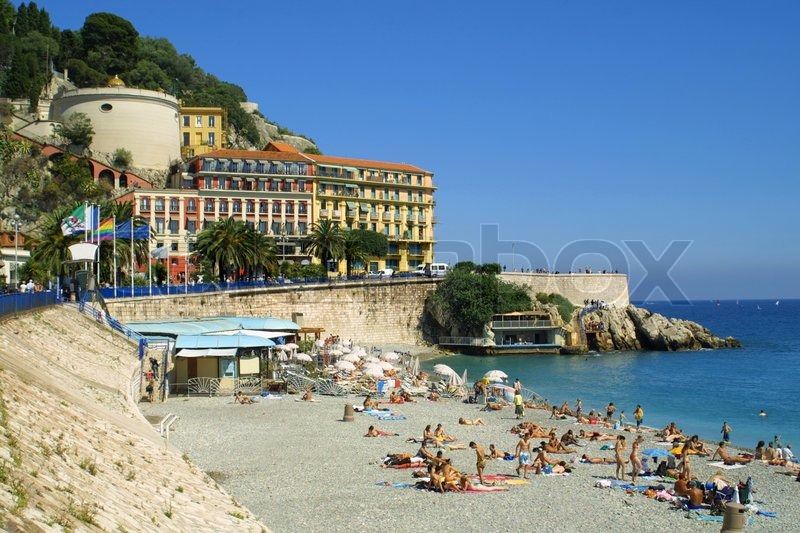 Stock image of 'Crowded Mediterranean summer beach in City of Nice, France'