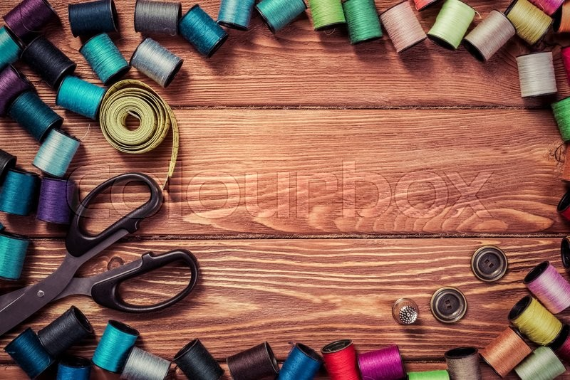 Bright image of sewing kit accessories on wooden table, stock photo