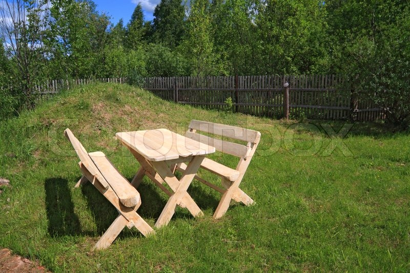 Wooden furniture in summer park, stock photo