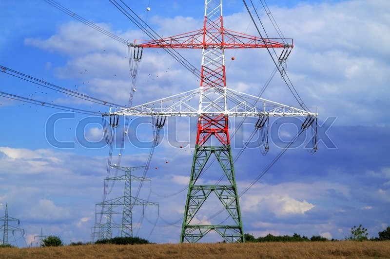 High electricity pylons in the pasture in Czech Republic, stock photo