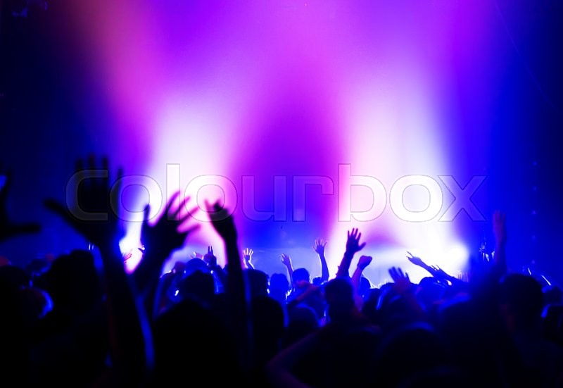 Stock image of 'silhouettes of a massive crowd at the party concert club music happy'