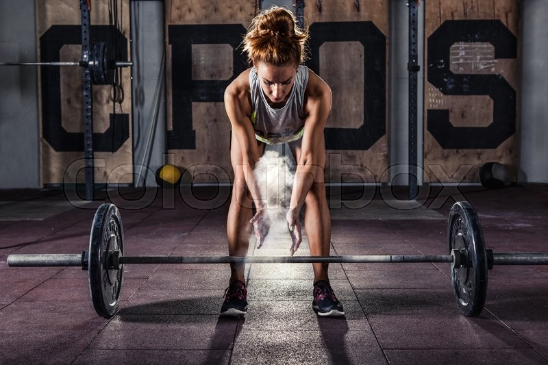 Girl getting ready for crossfit training, stock photo