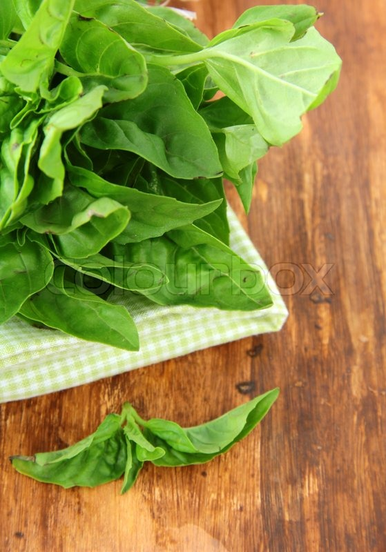Bunch of fresh basil on a napkin on the table, stock photo