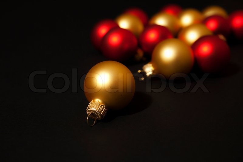 gold and red christmas ornaments on black background stock photo colourbox - Black And Gold Christmas Ornaments
