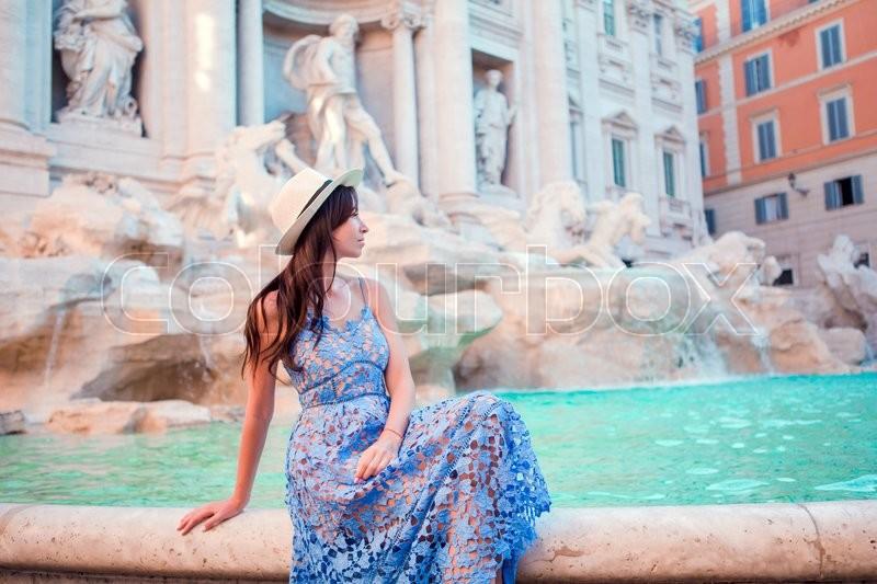 Beautiful woman near Trevi Fountain, Rome, Italy. Happy girl enjoy italian vacation holiday in Europe, stock photo
