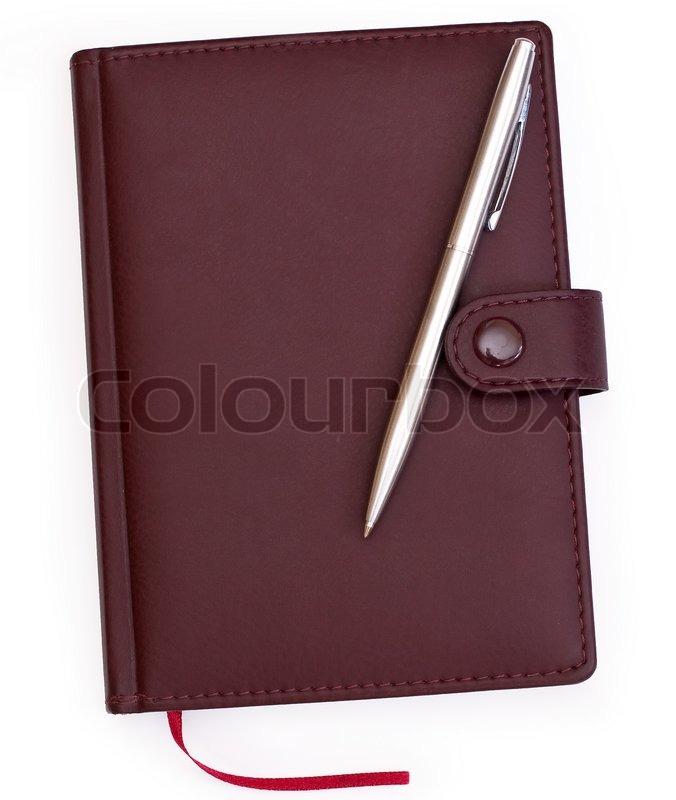 braun rot leder notebook mit stift stockfoto colourbox. Black Bedroom Furniture Sets. Home Design Ideas
