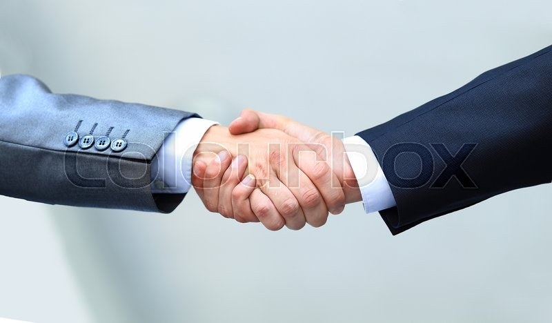 Shaking hands in the office at the beginning of the working day, stock photo