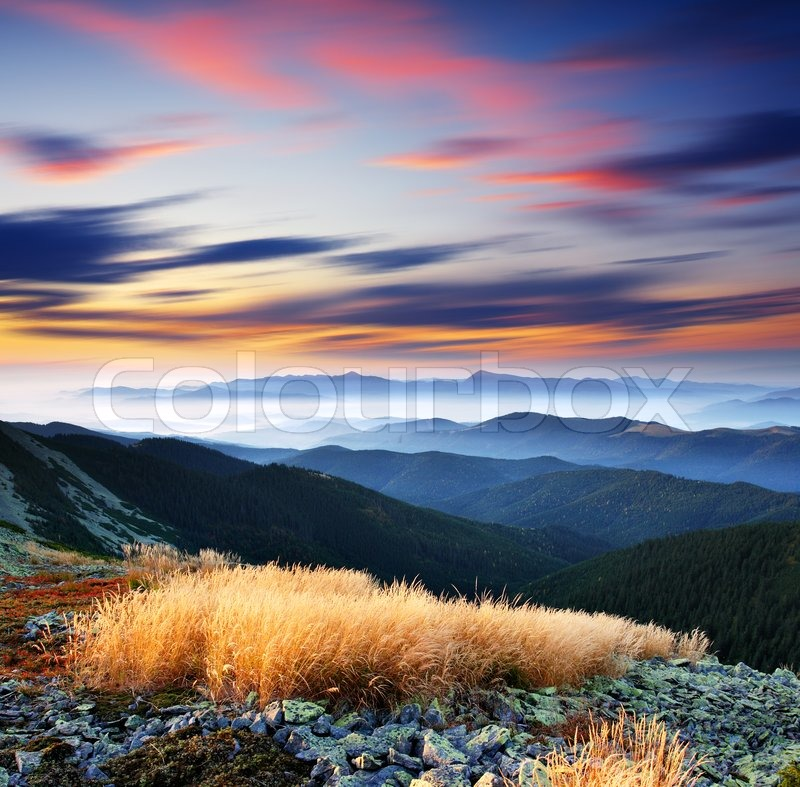 Majestic sunset in the mountains landscape. HDR image, stock photo