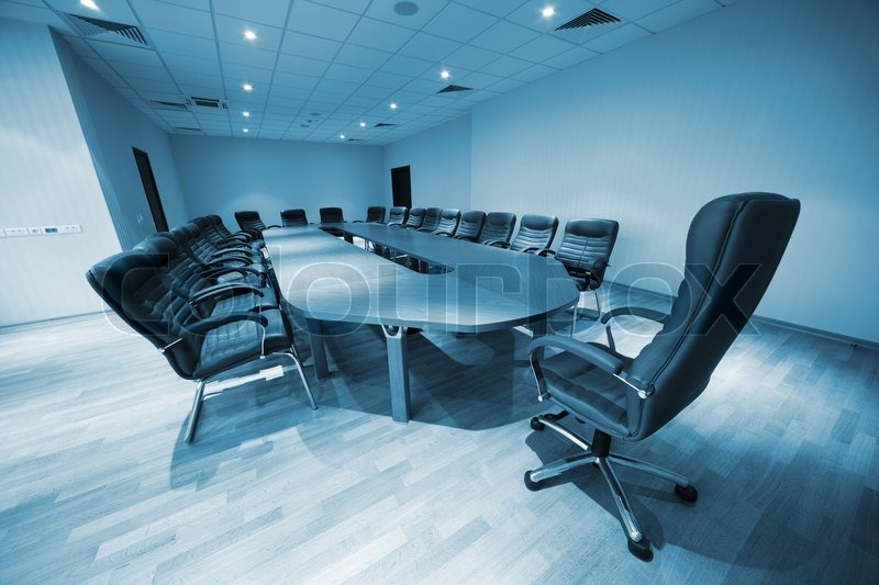A large table and chairs in a modern conference room, stock photo