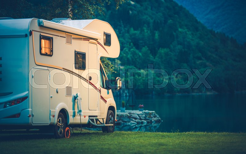 Camper Camping at the Glacier Lake. Camper Van Vacation, stock photo