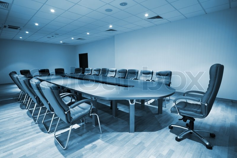 Large Table And Chairs In A Modern Conference Room Stock Photo - Blue conference table
