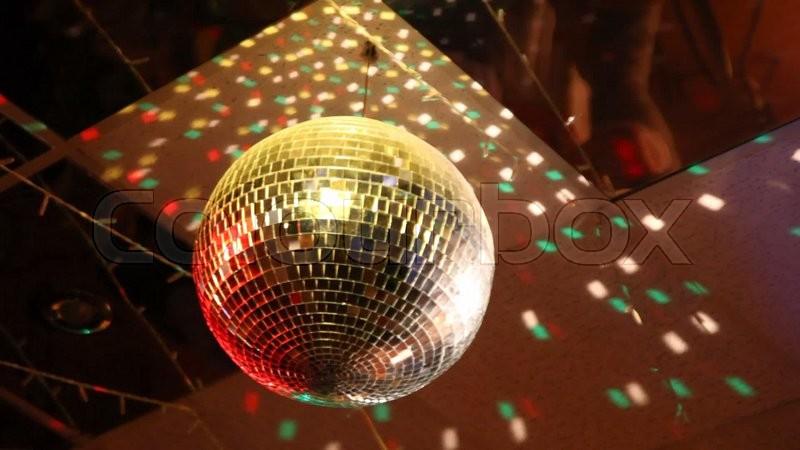 Rotating Mirror Disco Ball In Night Club