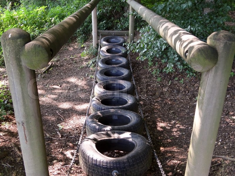 Stock image of playground tire bridge
