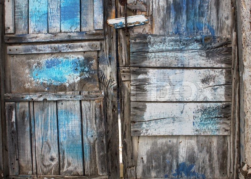 Old Rotten Wooden Door With Cracked Blue Paint Stains Stock Photo Colourbox