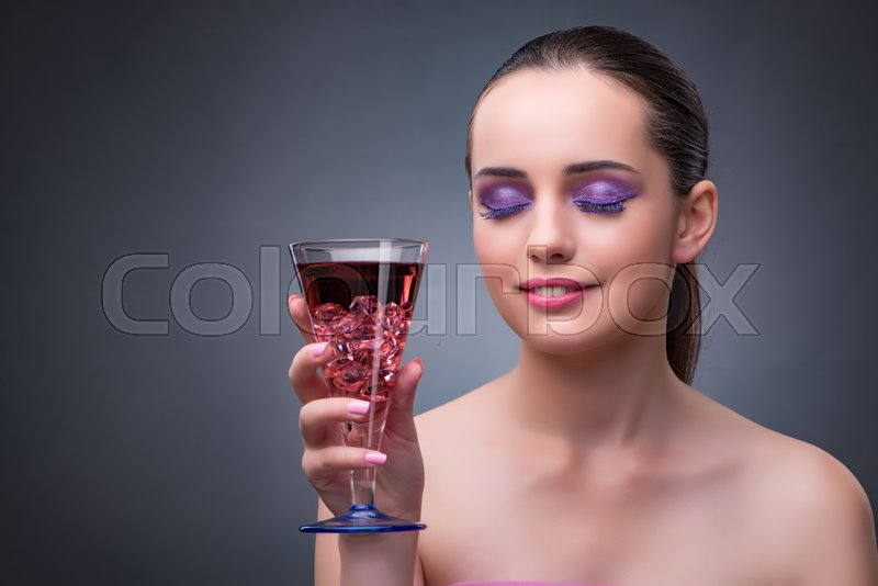 Nice woman drinking red cocktail, stock photo