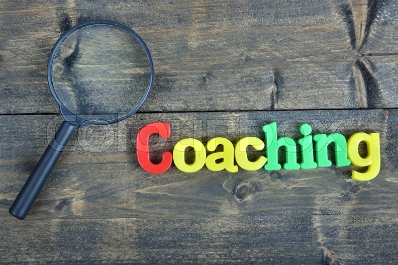 Coaching word on wooden table, stock photo