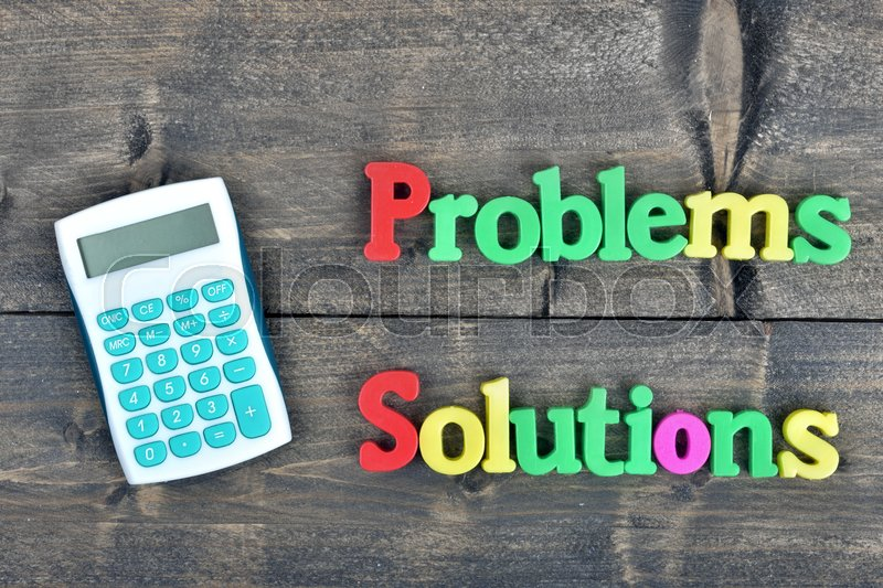 Problems and Solutions word on wooden table, stock photo