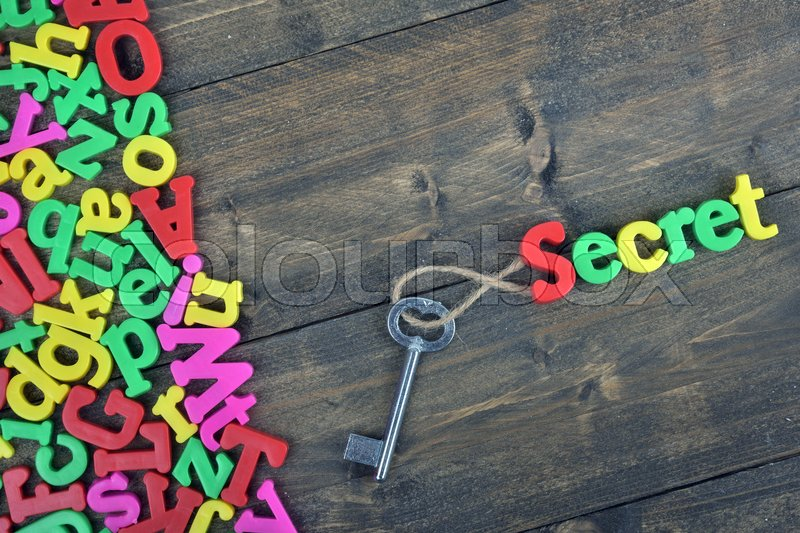 Secret word on wooden table, stock photo