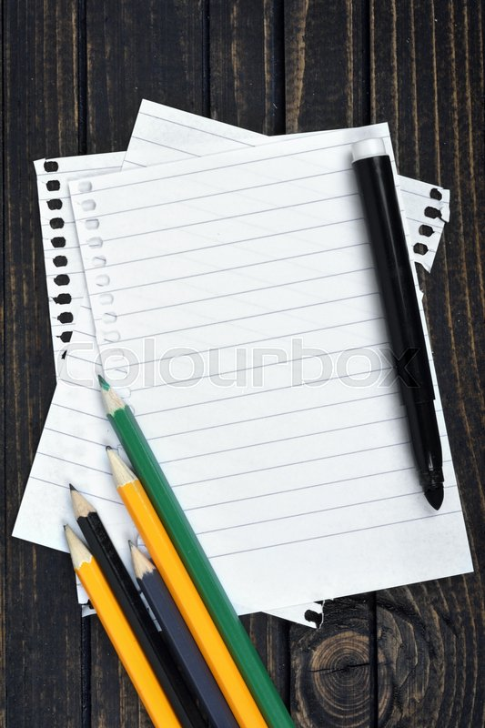 Empty paper and office tools on wooden table, stock photo
