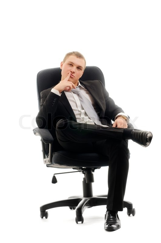 Young man sitting in chair isolated over white stock for Sitting chairs