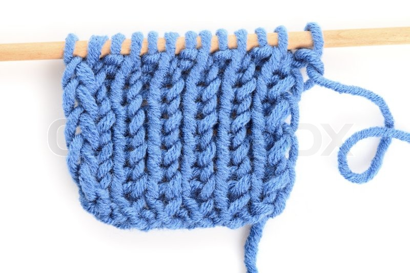 b090d3fa3 Knitting close up with blue woven ...