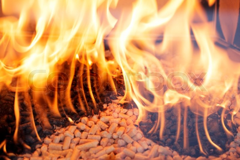Alternative fuel wood pellets burning in a fireplace