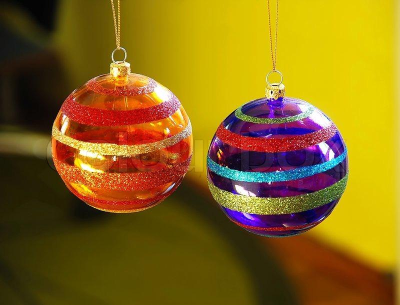 Two Purple And Orange Christmas Balls Decorations Closeup