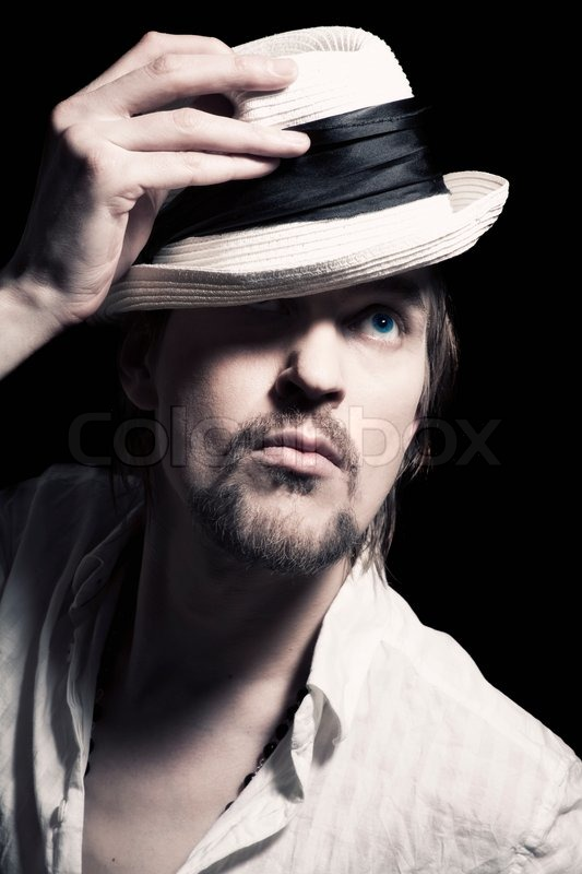 Stock image of  Studio portrait of a handsome young man with a white hat in ea52bbde1e4