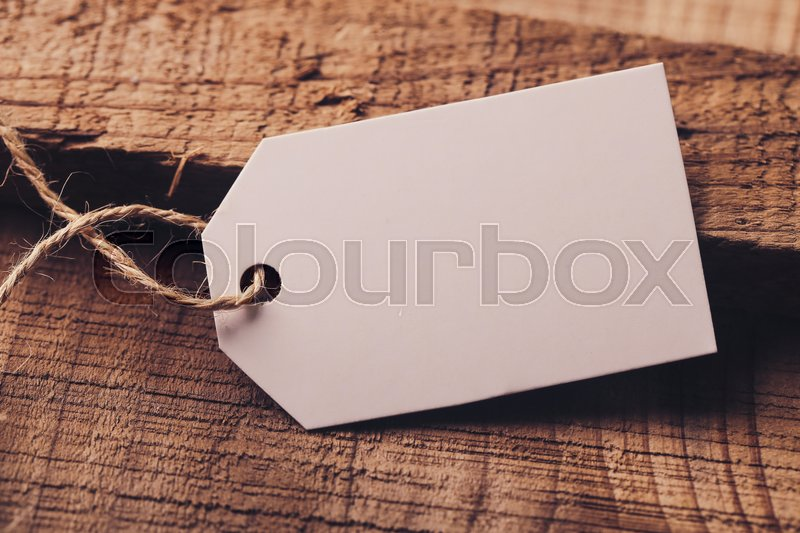 Blank white label is on the wood for your edit, stock photo