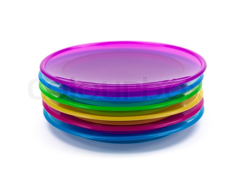 A stack of plastic plates isolated against a white background stock photo  sc 1 st  Colourbox & A stack of plastic plates isolated against a white background ...