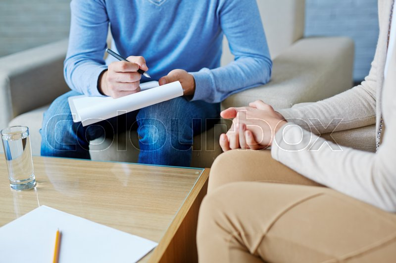 Young woman visiting her psychologist, stock photo