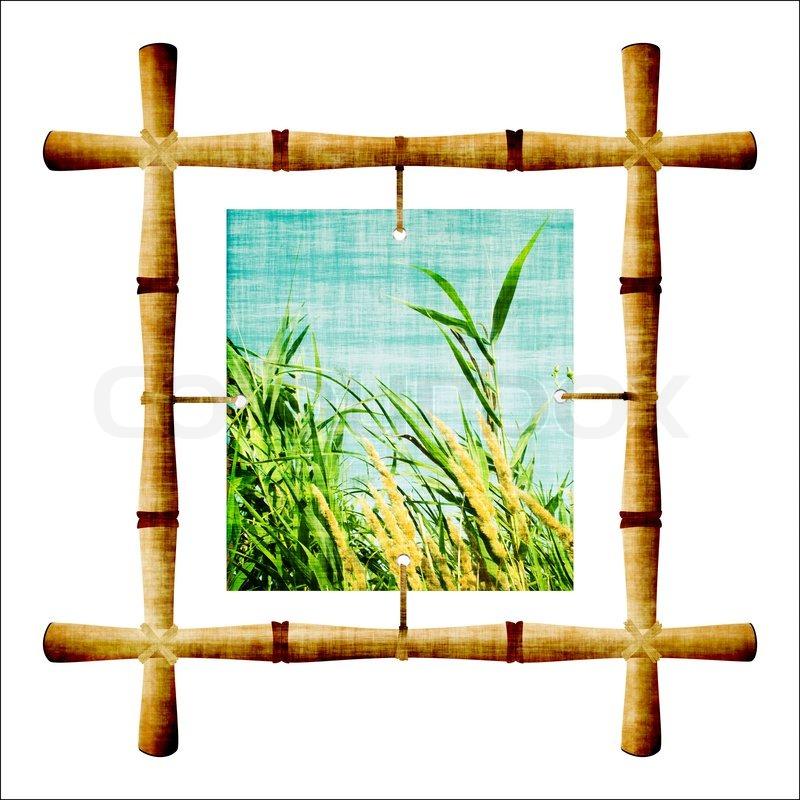 Bambus-Rahmen mit einem Bild , isoliert auf weiß | Stockfoto | Colourbox