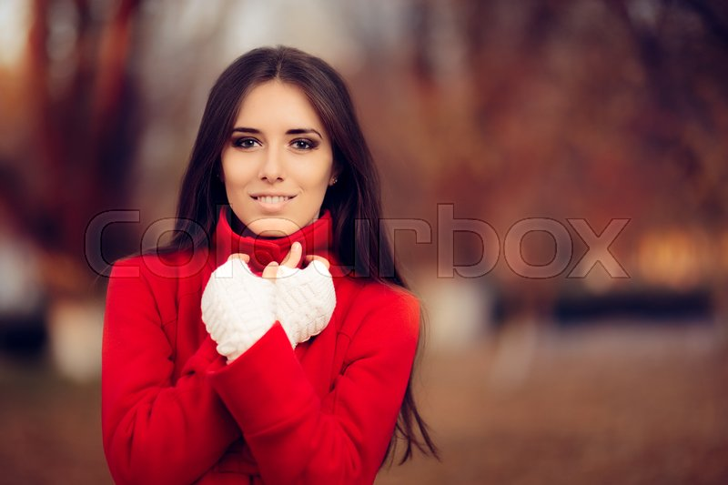 Autumn Woman Wearing Red Coat and Knitted Fingerless Gloves, stock photo