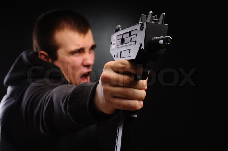 the shouting man with pair of uzi stock photo colourbox