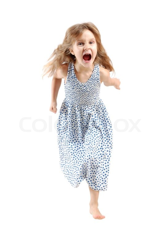 adorable caucasian 5 year old girl running and screaming over white