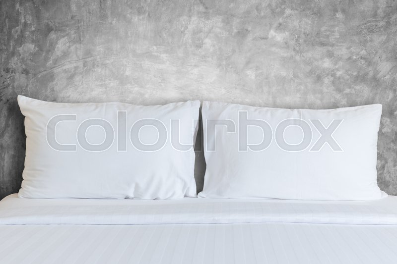 Close up white bedding sheets and pillow in hotel room, stock photo