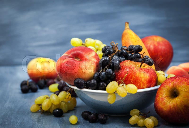 Fresh ripe autumnal fruits - peaches, pears, apples and grapes , stock photo