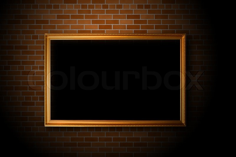 Empty frame hanging on the brick wall | Stock Photo | Colourbox