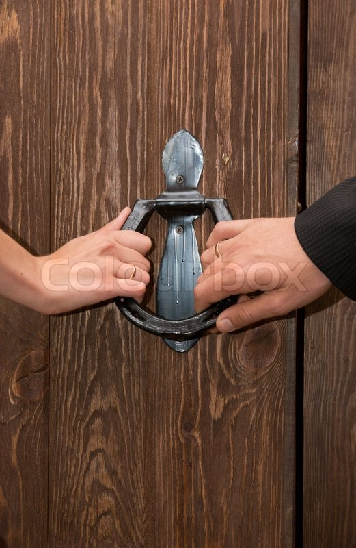 Close up of just married hands opening the door together | Stock Photo | Colourbox & Close up of just married hands opening the door together | Stock ...