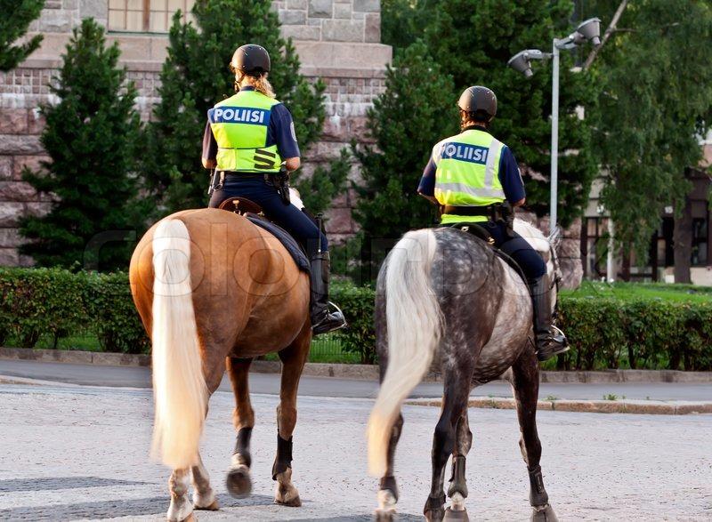 Two Girls Policeman On A Horse In Helsinki Finland