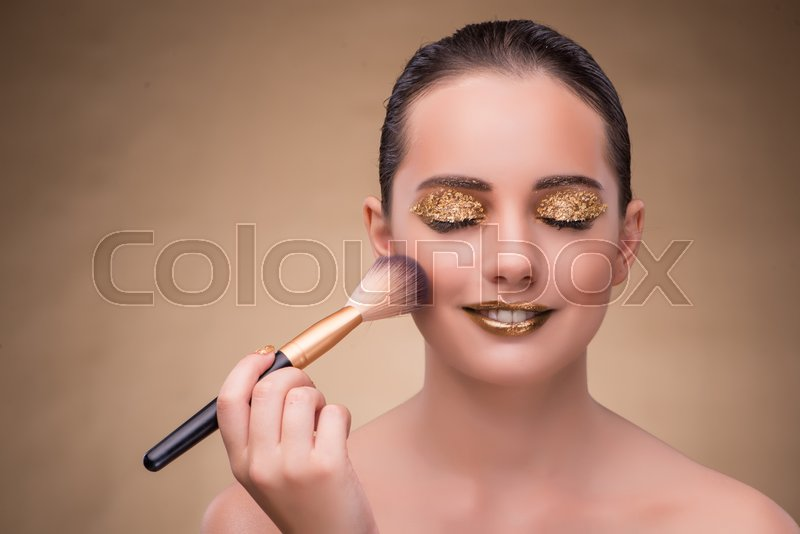 Woman during cosmetics session in fashion concept, stock photo