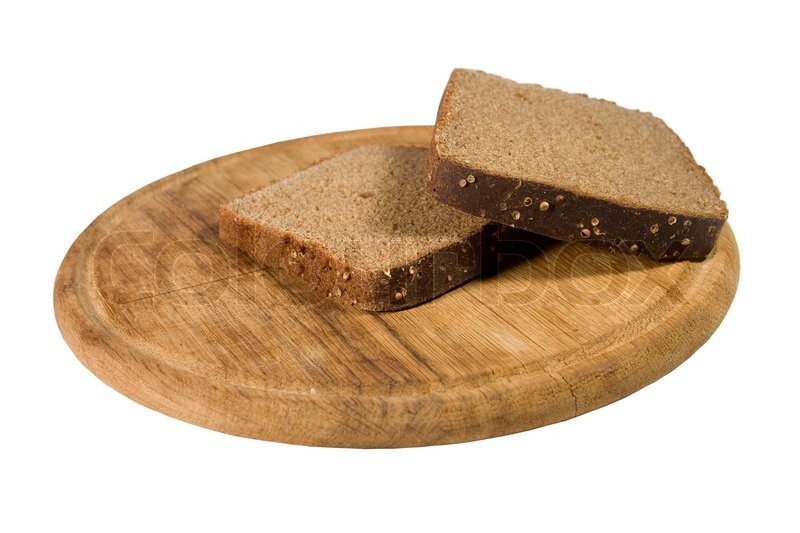Two slices of brown bread on a wooden plate (isolated on ...