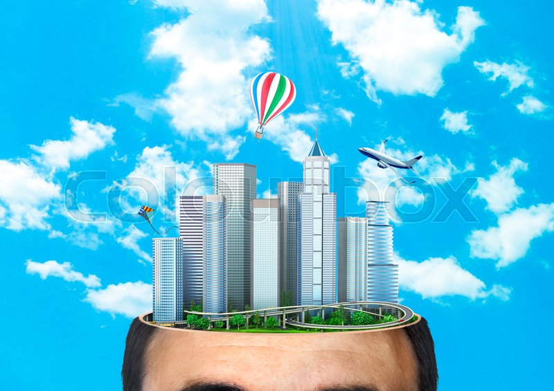 Concept of dreaming. City of the future in the cut of head against the background of the sky. Concept of planning. Thinking. , stock photo